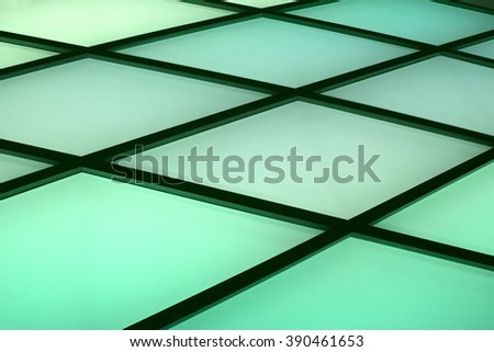Glass panels on a wall, ceiling or floor. Abstract interior composition. Toned photo in shades of green with metaphorical relation to green technologies, natural or eco-friendly construction materials - stock photo