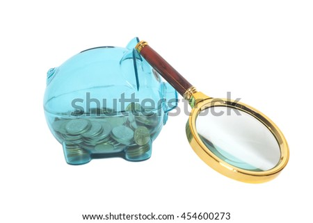 Glass Piggy bank with coins and magnifying glass isolated on white - stock photo