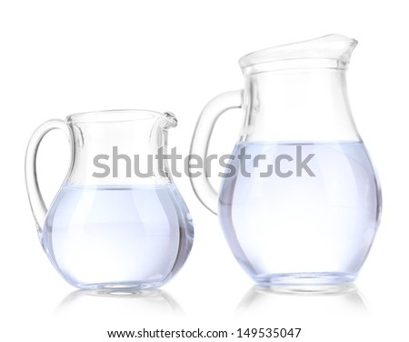 Glass pitchers of water isolated on white - stock photo