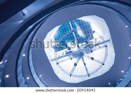 glass roof with illumination on a background blue sky - stock photo