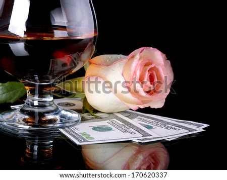 Glass, rose and money. Alcohol, flower and dollars. Glass with drink and a pink rose with dollars. - stock photo