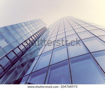 glass silhouettes on modern building - stock photo