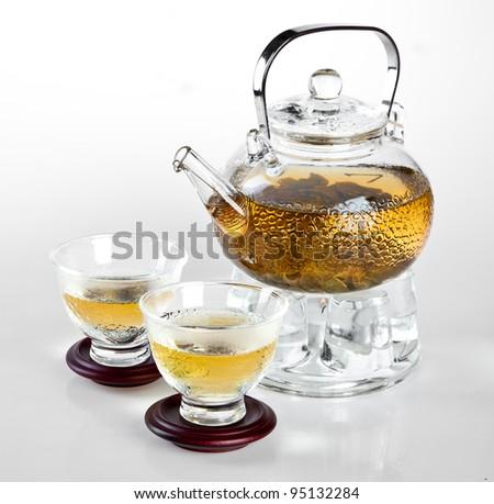 glass teapot Chinese tea on the white - stock photo