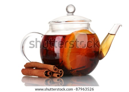 Glass teapot with black tea of orange and cinnamon isolated on white - stock photo