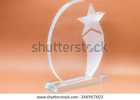 glass trophy in brown background : concept to the winner - stock photo