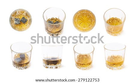 Glass tumbler filled with whiskey bourbon isolated over the white background, set of multiple image versions with and without the cooling granite stones - stock photo