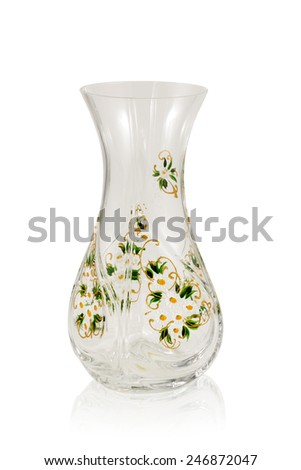 Glass vase for flowers with a beautiful ornament isolated on a white background - stock photo
