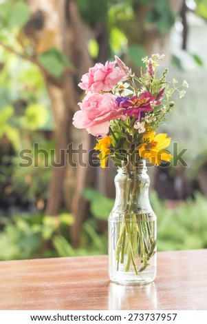 Glass vase with beautiful flowers - stock photo