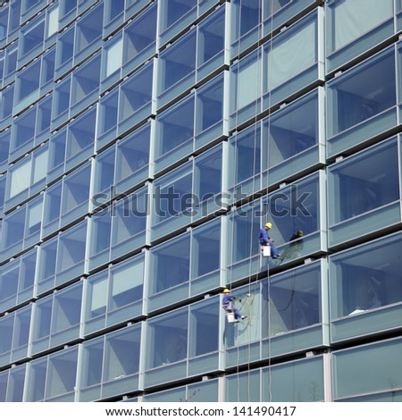 Glass wall cleaning - stock photo
