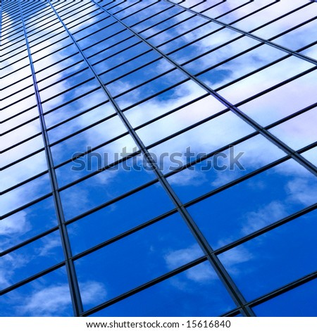 Glass wall of business center and sky reflection, may be used as background - stock photo