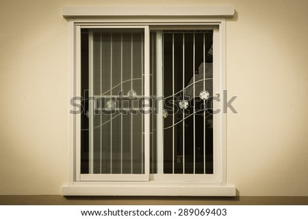 Glass window with curved steel ; vintage image  - stock photo