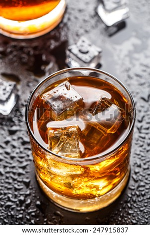 Glass with alcoholic drink - stock photo