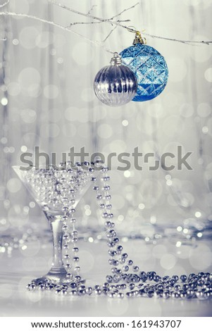 Glass with beads, Christmas tree ornaments. - stock photo