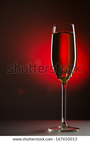 glass with champagne on background - stock photo