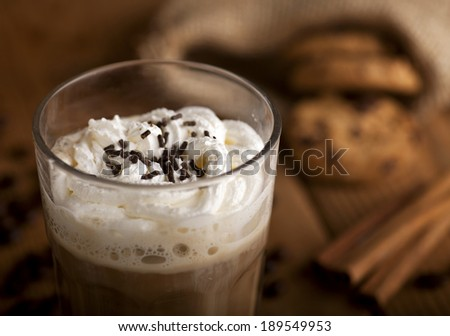 Glass with coffee hot chocolate cappuccino latte or mochaccino and cookies on a wooden background. - stock photo