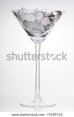 Glass with coin on the white background - stock photo