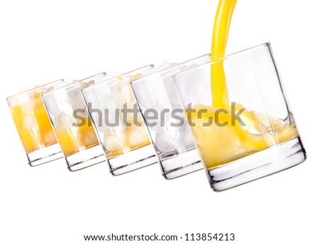 Glass with fresh multi fruit juice on white background - stock photo