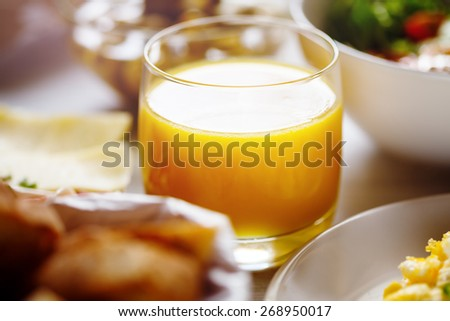 Glass with Fresh Orange Juice. Breakfast Concept. Selective focus, shallow DOF. - stock photo