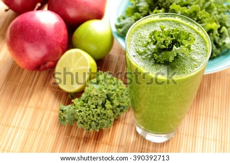 Glass with healthy smoothie with green kale, apple and lime - stock photo