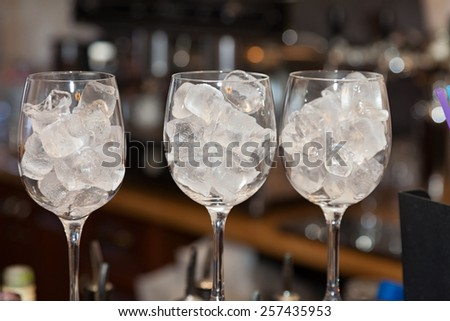 Glass with ice cubes closeup - stock photo