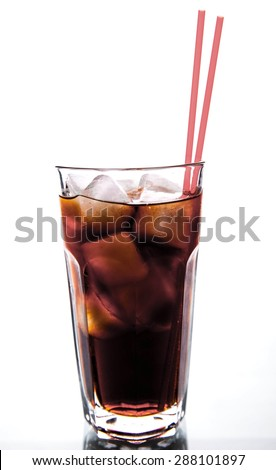 glass with ice with red tube. soft drinks - stock photo