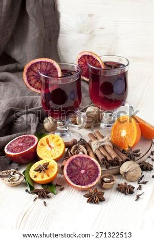 Glass with mulled wine and spices - stock photo