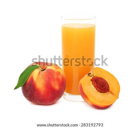 Glass with peach juice and ripe peaches isolated on white background - stock photo