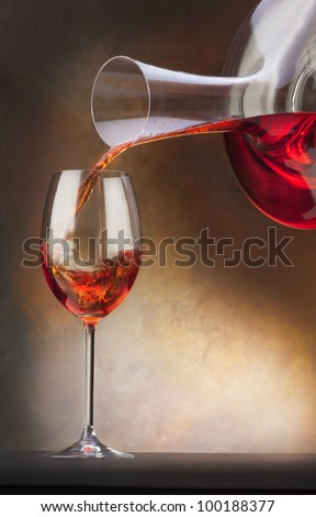 glass with red wine and decanter - stock photo