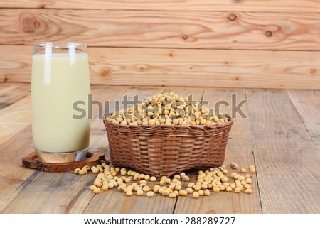 Glass with Soy Milk and Seeds on wooden background - stock photo