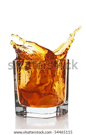 Glass with splashing whisky drink. Isolated on a white background - stock photo