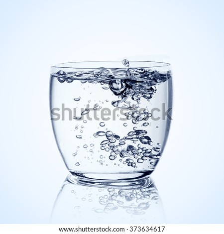 glass with water over white background - stock photo