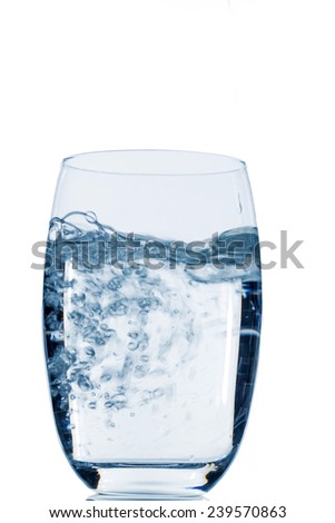 glass with water, symbolic photo for drinking water, freshness, supplies and consumables - stock photo