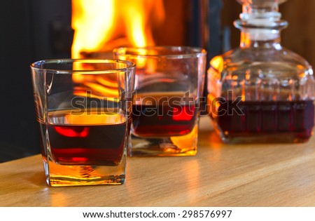glass with whiskey on a wooden table - stock photo