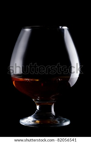 Glass with whisky isolated on black - stock photo