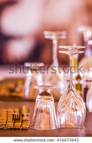 glasses and cutlery in a restaurant table setting - stock photo