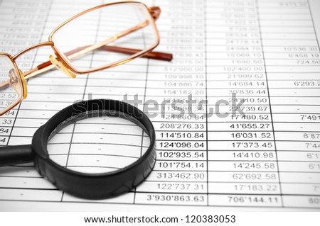 Glasses and magnifiers on the documents. - stock photo