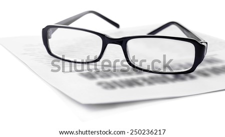 Glasses and newspapers, close-up - stock photo