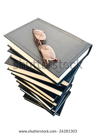 glasses at the top of the blue books pile - stock photo