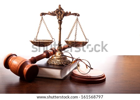 Glasses, book,gavel, bronze scales with small plates on the chains on the table - stock photo