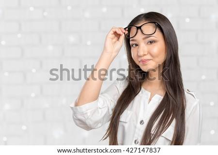 Glasses eyewear woman happy portrait looking at camera - stock photo