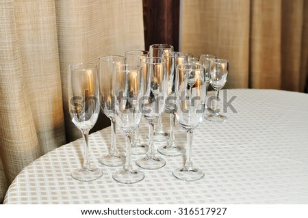 Glasses for champagne on a table. - stock photo