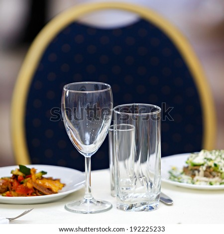 Glasses for drinks and cocktails at the festive table. - stock photo