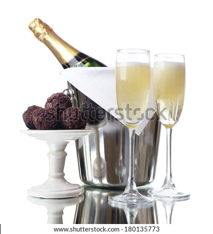 Glasses of champagne and bottle in pail on light background - stock photo