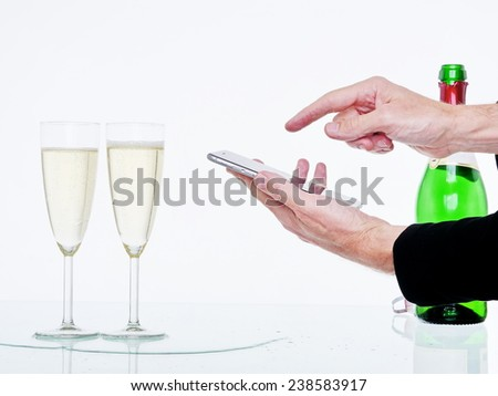 glasses of champagne and streamer on tablet background - stock photo