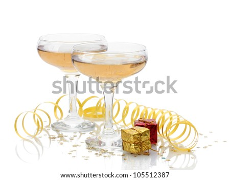 glasses of champagne, gifts and serpentine isolated on a white - stock photo