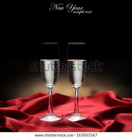 glasses of champagne in dark space  - stock photo