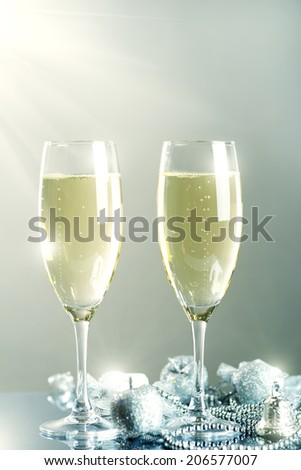 Glasses of champagne. on light background - stock photo