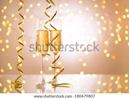 Glasses of champagne on shiny background - stock photo