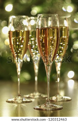 Glasses of champagne sparkle with festive background - stock photo