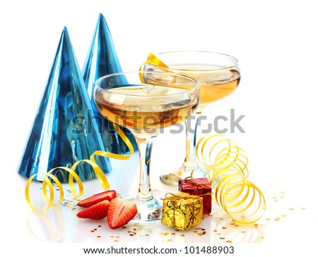 glasses of champagne, strawberries, party hats and gifts isolated on a white - stock photo